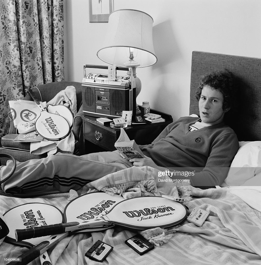 US tennis player <a gi-track='captionPersonalityLinkClicked' href=/galleries/search?phrase=John+McEnroe&family=editorial&specificpeople=159411 ng-click='$event.stopPropagation()'>John McEnroe</a> relaxes with a tape player, a Robert Ludlum novel, and a selection of Wilson rackets, 1979.