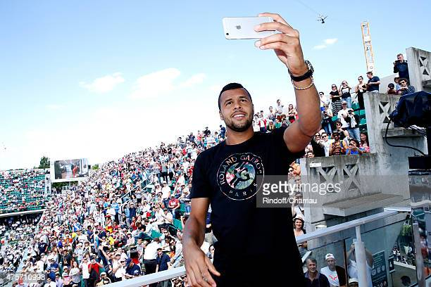 Tennis Player JoWilfried Tsonga does a 'Selfie' and 'Hi' the public from France Television french chanel studio during the 2015 Roland Garros French...