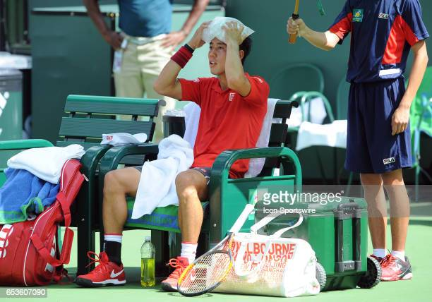 ATP tennis player Kei Nishikori icing down during a break in the action of the second set of a match against Donald Young on March 15 during the BNP...