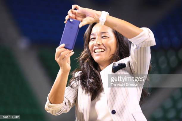 Tennis player Kimiko Date takes pictures during a press conference on her second retirement at Ariake Coliseum on September 7 2017 in Tokyo Japan...