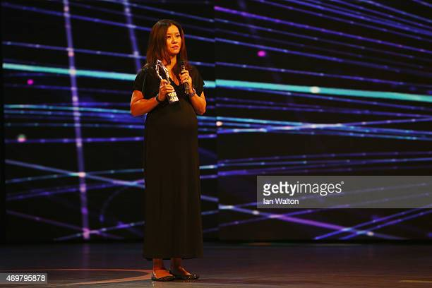 Tennis player Li Na of China accepts the Laureus Academy Exceptional Achievement award during the 2015 Laureus World Sports Awards show at the...