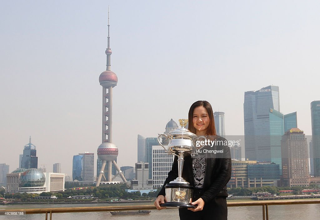 Tennis player Li Na of China holds the Australian Open trophy during the Australian Open Women In Focus Lunch at M on the Bud on October 16, 2015 in Shanghai, China.