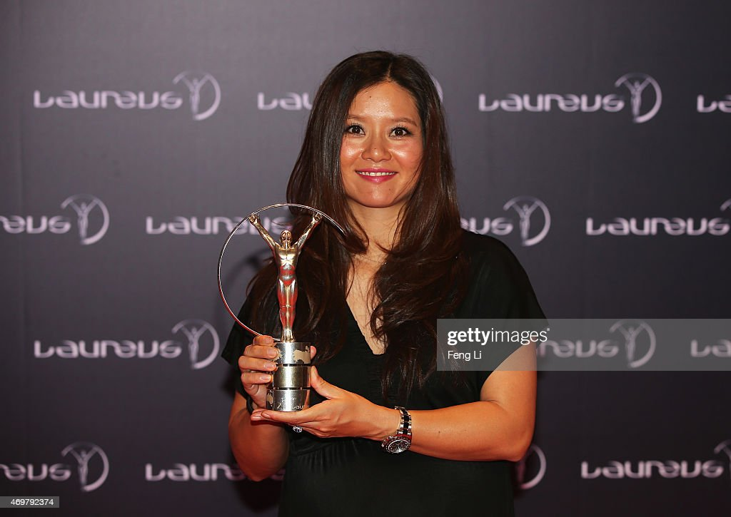 Tennis player Li Na of China poses with her Laureus Academy Exceptional Achievement award at the winners press photocall during the 2015 Laureus World Sports Awards at the Shanghai Grand Theatre on April 15, 2015 in Shanghai, China.