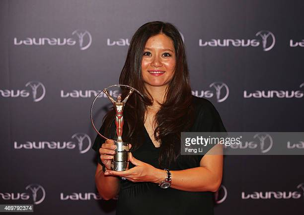 Tennis player Li Na of China poses with her Laureus Academy Exceptional Achievement award at the winners press photocall during the 2015 Laureus...
