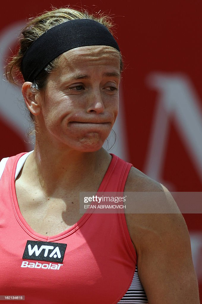 Tennis player Lina Dominguez of Spain reacts after loosing a point against Catalina Castano of Colombia, during their WTA Bogota Open match, in the Colombian capital, on February 19, 2013. AFP PHOTO/Eitan Abramovich