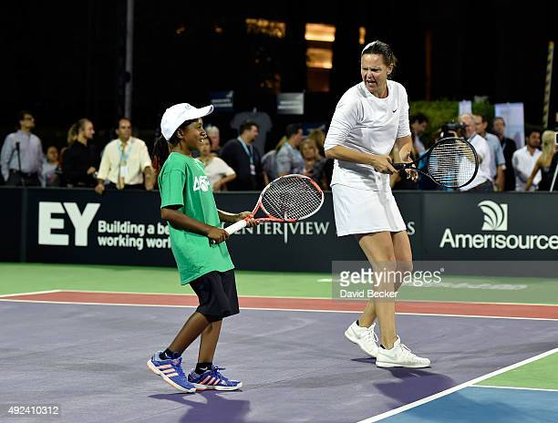 Tennis player Lindsay Davenport plays with her new 'teammate' a ball girl at the Mylan World TeamTennis Smash Hits charity tennis event at Caesars...