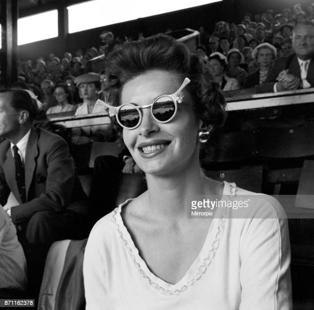 Tennis player Lorna Cawthorn taking a days rest to watch the action at Wimbledon 27th June 1956