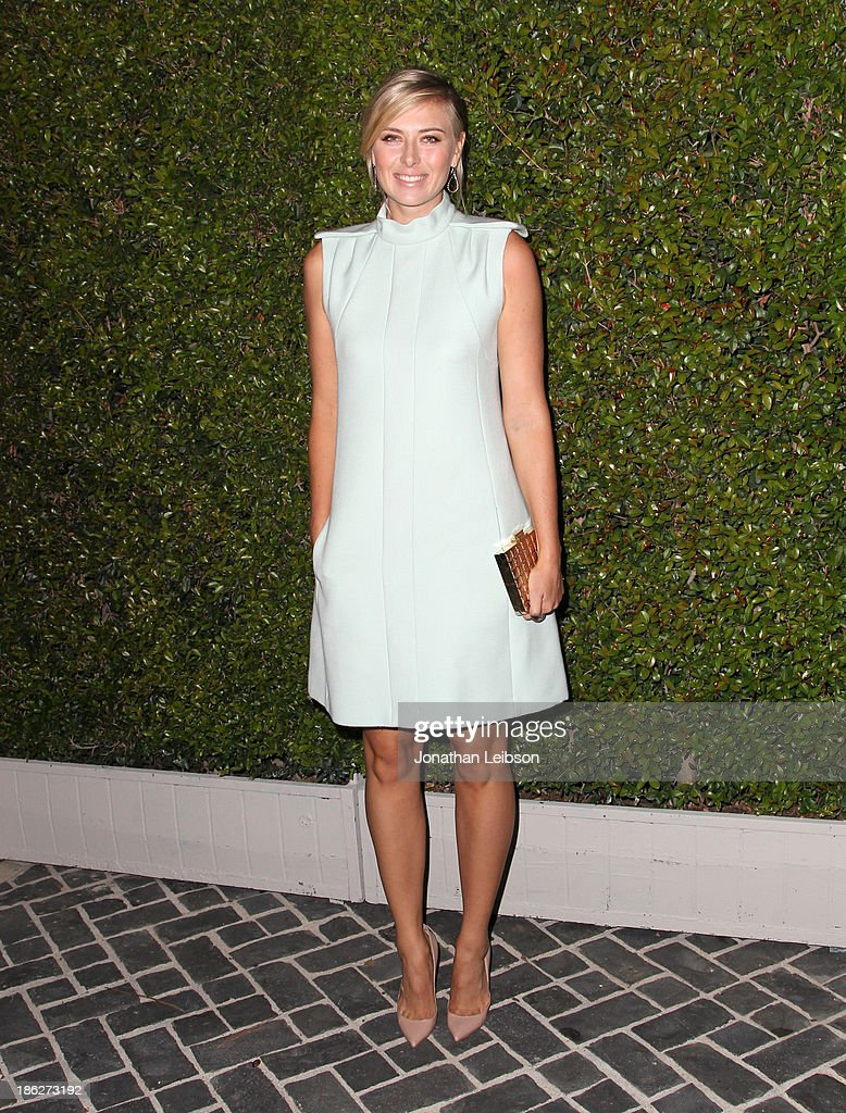 Tennis player <a gi-track='captionPersonalityLinkClicked' href=/galleries/search?phrase=Maria+Sharapova&family=editorial&specificpeople=157600 ng-click='$event.stopPropagation()'>Maria Sharapova</a> attends Chloe Los Angeles Fashion Show & Dinner hosted by Clare Waight Keller, January Jones and Lisa Love on October 29, 2013 in Los Angeles, California.