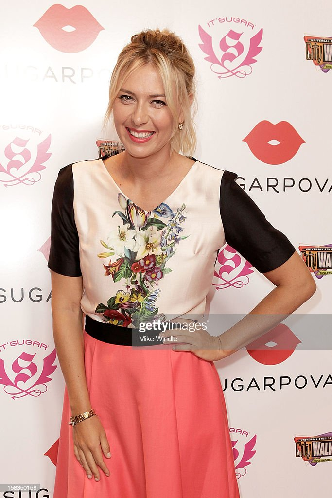Tennis player <a gi-track='captionPersonalityLinkClicked' href=/galleries/search?phrase=Maria+Sharapova&family=editorial&specificpeople=157600 ng-click='$event.stopPropagation()'>Maria Sharapova</a> poses during <a gi-track='captionPersonalityLinkClicked' href=/galleries/search?phrase=Maria+Sharapova&family=editorial&specificpeople=157600 ng-click='$event.stopPropagation()'>Maria Sharapova</a> launches her Sugarpova candy collection on the West Coast at It'Sugar on December 13, 2012 in Universal City, California.