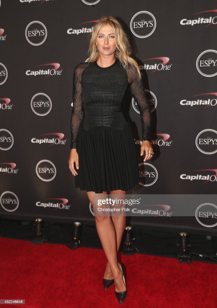Tennis player <a gi-track='captionPersonalityLinkClicked' href=/galleries/search?phrase=Maria+Sharapova&family=editorial&specificpeople=157600 ng-click='$event.stopPropagation()'>Maria Sharapova</a> presents award for Best Game at The 2014 ESPYS at Nokia Theatre L.A. Live on July 16, 2014 in Los Angeles, California.
