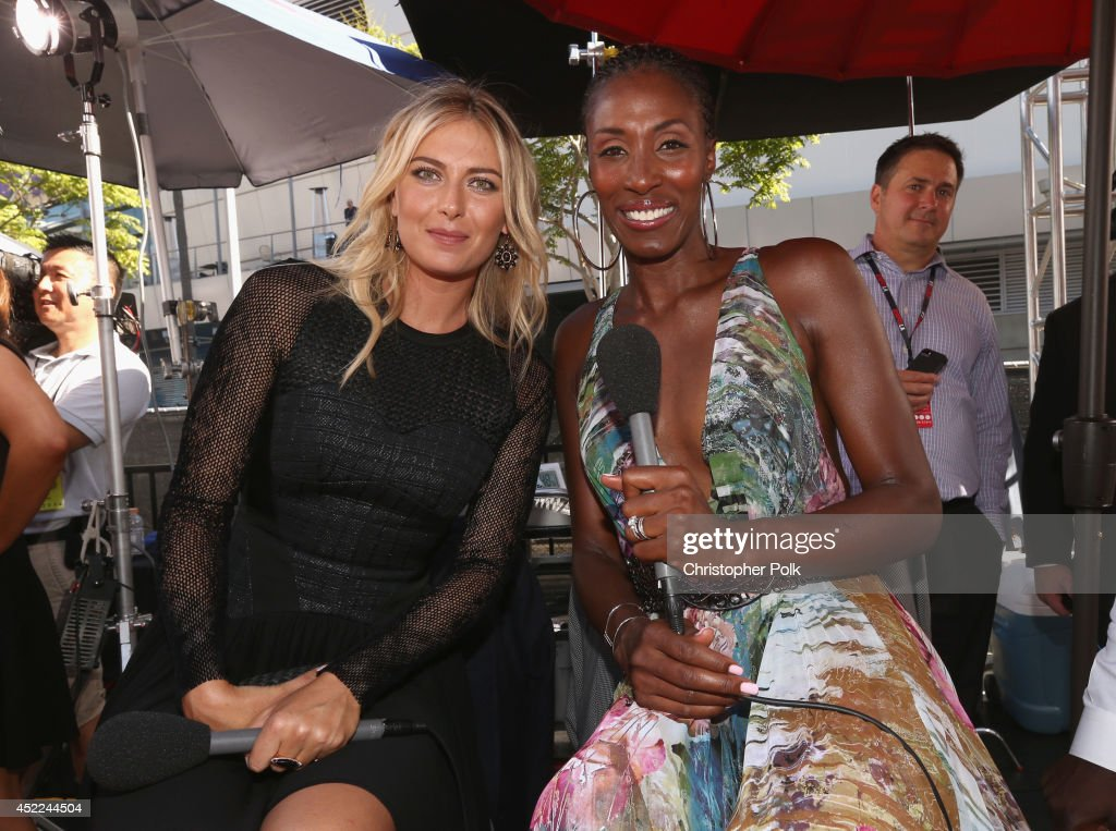 Tennis player <a gi-track='captionPersonalityLinkClicked' href=/galleries/search?phrase=Maria+Sharapova&family=editorial&specificpeople=157600 ng-click='$event.stopPropagation()'>Maria Sharapova</a> with former WNBA player <a gi-track='captionPersonalityLinkClicked' href=/galleries/search?phrase=Lisa+Leslie&family=editorial&specificpeople=202228 ng-click='$event.stopPropagation()'>Lisa Leslie</a> attends The 2014 ESPYS at Nokia Theatre L.A. Live on July 16, 2014 in Los Angeles, California.