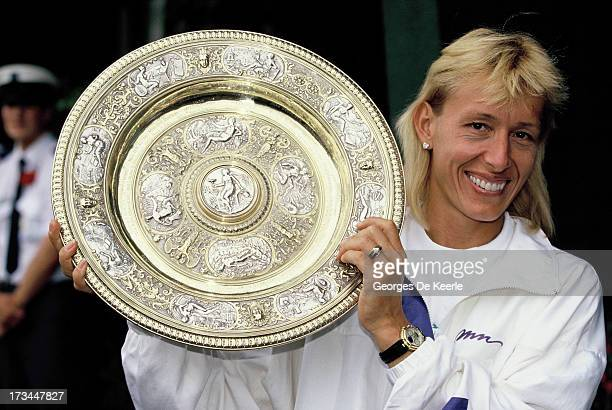 Tennis player Martina Navratilova with her trophy after winning the Women's Singles at the Wimbledon Championships on July 8 1990 in London England