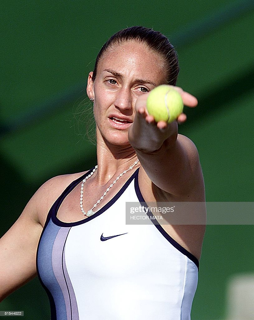 Tennis player Mary Pierce prepares to serve again