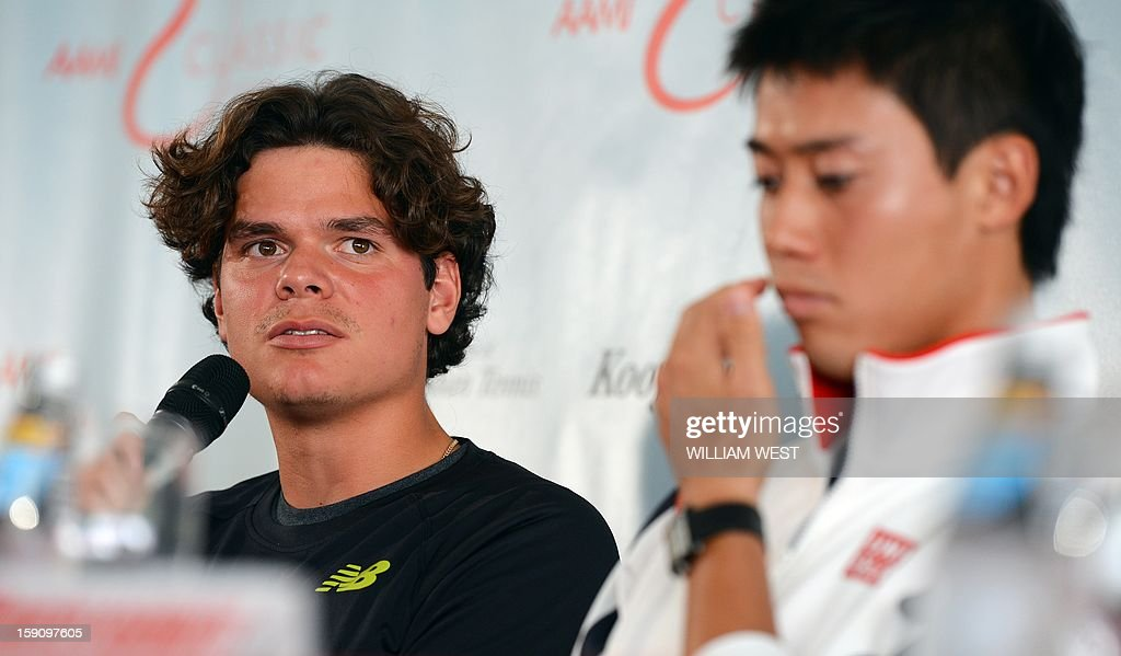 Tennis player Milos Raonic of Canada (L) answers a question as Kei Nishikori of Japan (R) listens at a press conference at the Kooyong Classic in Melbourne on January 8, 2013. An invitational event which features seven top male players ranked in the top 20, the Kooyong Classic is used by the players as a warm-up for the Australian Open which runs January 14-27. AFP PHOTO/William WEST IMAGE