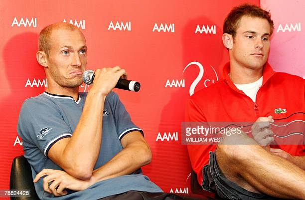 Tennis player Nikolay Davydenko of Russia answers a question as Andy Roddick of the US listens during a press conference at the Kooyong Classic...