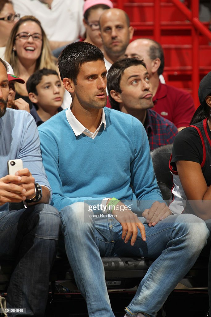 Tennis player <a gi-track='captionPersonalityLinkClicked' href=/galleries/search?phrase=Novak+Djokovic&family=editorial&specificpeople=588315 ng-click='$event.stopPropagation()'>Novak Djokovic</a> attends a game between the Charlotte Bobcats and the Miami Heat on March 24, 2013 at American Airlines Arena in Miami, Florida.