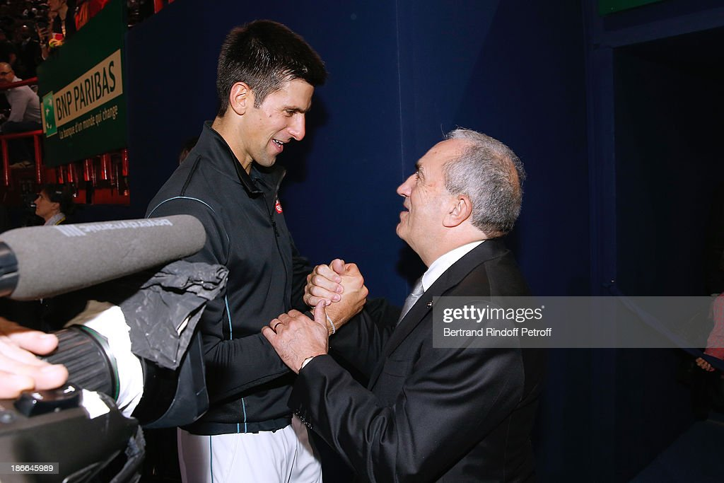 Tennis player Novak Djokovic of Serbia and President of French Tennis Federation Jean Gachassin after the match against Roger Federer during day six of the BNP Paribas Tennis Masters, held at Bercy on November 2, 2013 in Paris, France.