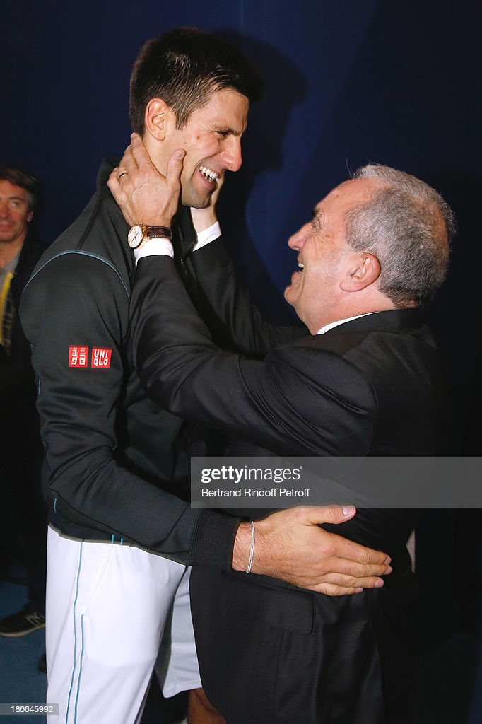 Tennis player <a gi-track='captionPersonalityLinkClicked' href=/galleries/search?phrase=Novak+Djokovic&family=editorial&specificpeople=588315 ng-click='$event.stopPropagation()'>Novak Djokovic</a> of Serbia and President of French Tennis Federation <a gi-track='captionPersonalityLinkClicked' href=/galleries/search?phrase=Jean+Gachassin&family=editorial&specificpeople=5701397 ng-click='$event.stopPropagation()'>Jean Gachassin</a> after the match against Roger Federer during day six of the BNP Paribas Tennis Masters, held at Bercy on November 2, 2013 in Paris, France.