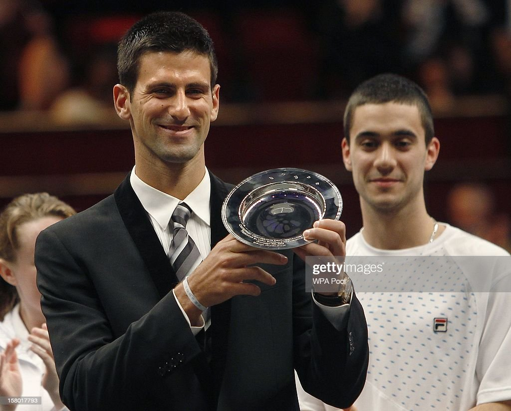 Tennis player <a gi-track='captionPersonalityLinkClicked' href=/galleries/search?phrase=Novak+Djokovic&family=editorial&specificpeople=588315 ng-click='$event.stopPropagation()'>Novak Djokovic</a> poses with the 'Centrepoint Premier Award for Contribution to the Lives of Youth Accross the World' he was awarded by Prince William, Duke of Cambridge in recognition of his Novak Djokavic Foundation at the Winter Whites Gala, in aid of the homeless charity Centrepoint, at the Royal Hall on December 8, 2012 in London, England.