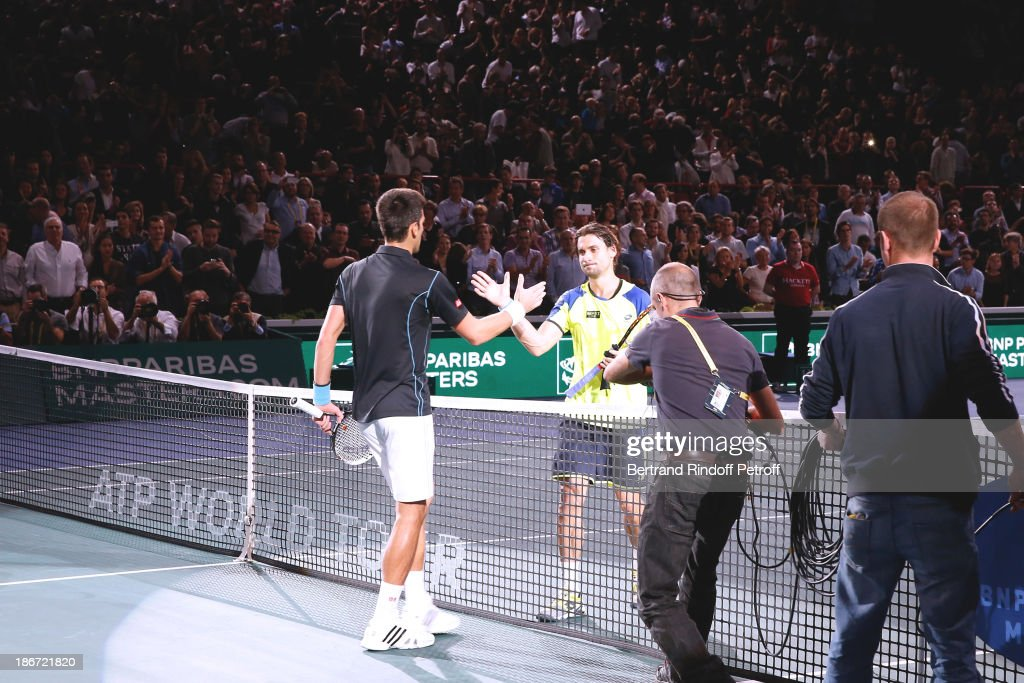 Tennis player <a gi-track='captionPersonalityLinkClicked' href=/galleries/search?phrase=Novak+Djokovic&family=editorial&specificpeople=588315 ng-click='$event.stopPropagation()'>Novak Djokovic</a> (L) won against <a gi-track='captionPersonalityLinkClicked' href=/galleries/search?phrase=David+Ferrer&family=editorial&specificpeople=208197 ng-click='$event.stopPropagation()'>David Ferrer</a> in the final of the BNP Paribas Tennis Masters, day seven, at Palais Omnisports de Bercy on November 3, 2013 in Paris, France.