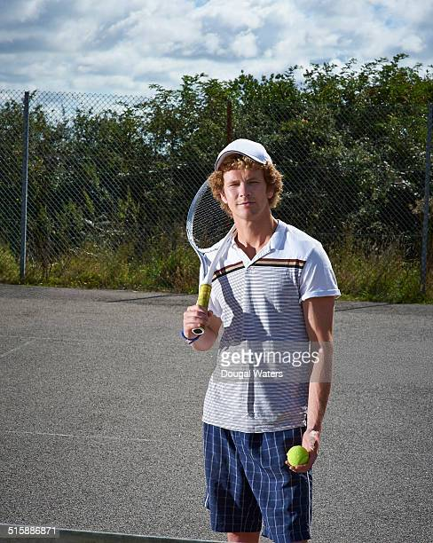 Tennis player on court with racket.