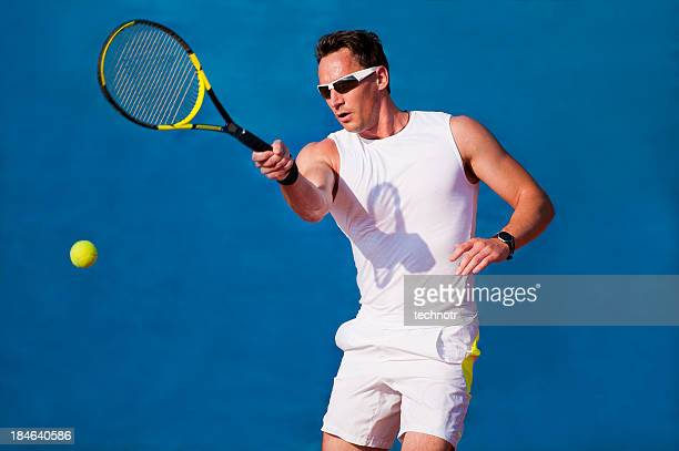 Tennis player on the blue background