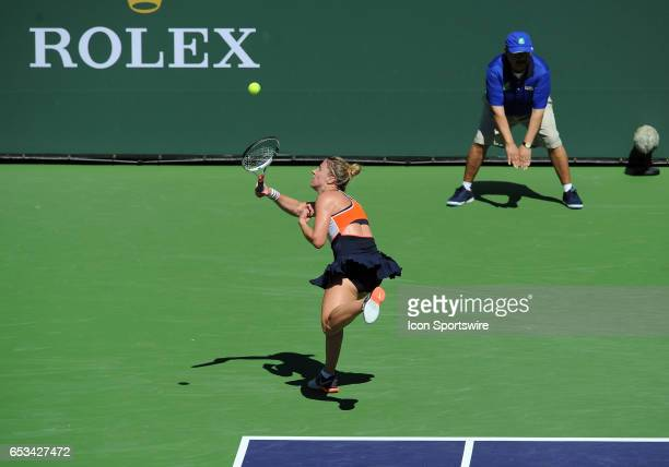 Tennis player Pauline Parmentier runs down the ball and returns a shot during a match against Angelique Kerber played on March 13 2017 at the Indian...