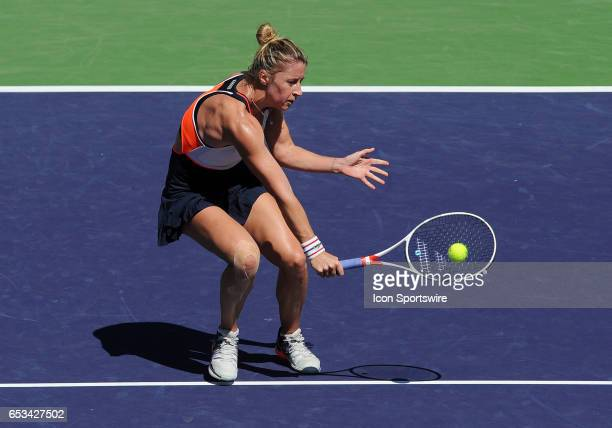 Tennis player Pauline Parmentier runs towards the net and returns a shot during a match against Angelique Kerber played on March 13 2017 at the...