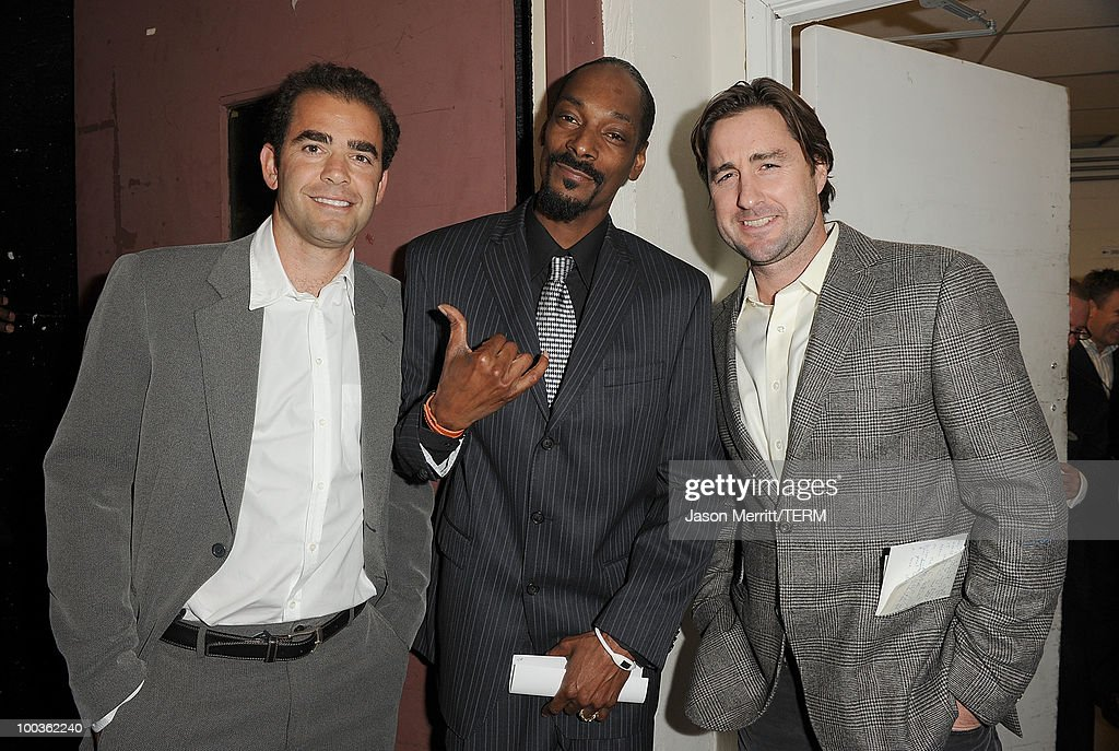 Tennis player Pete Sampras, singer Snoop Dogg, and actor Luke Wilson pose backstage at the 25th Anniversary Of Cedars-Sinai Sports Spectacular held at the Hyatt Regency Century Plaza Hotel on May 23, 2010 in Los Angeles, California.