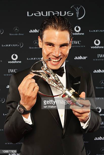 """Tennis Player Rafael Nadal of Spain poses with his award for """"Laureus World Sportsman of the Year"""" in the winners studio at the 2011 Laureus World..."""