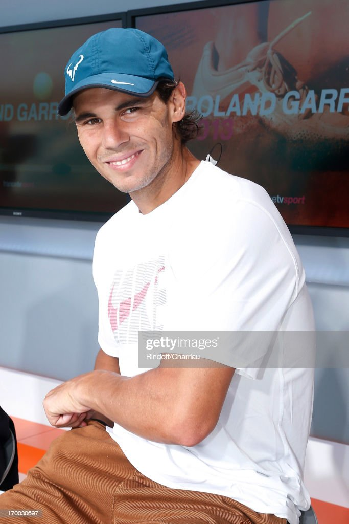 Tennis player <a gi-track='captionPersonalityLinkClicked' href=/galleries/search?phrase=Rafael+Nadal&family=editorial&specificpeople=194996 ng-click='$event.stopPropagation()'>Rafael Nadal</a> on France 2 french TV channel studio at Roland Garros Tennis French Open 2013 - Day 12 on June 6, 2013 in Paris, France.