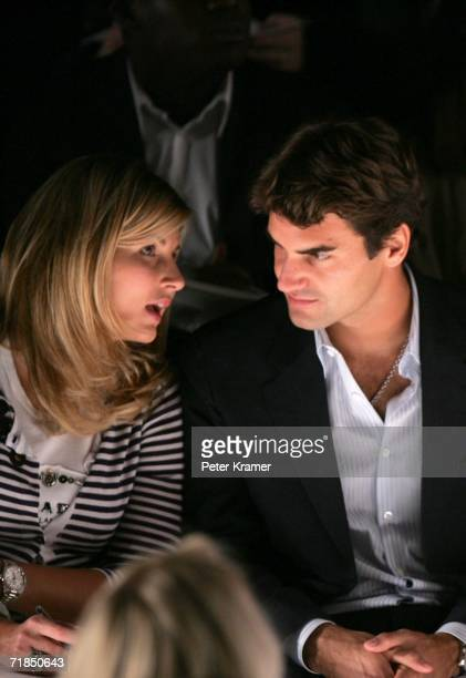 Tennis player Roger Federer and his girlfriend Mirka Vavrinec sit in the front row at the Oscar de la Renta Spring 2007 fashion show during Olympus...