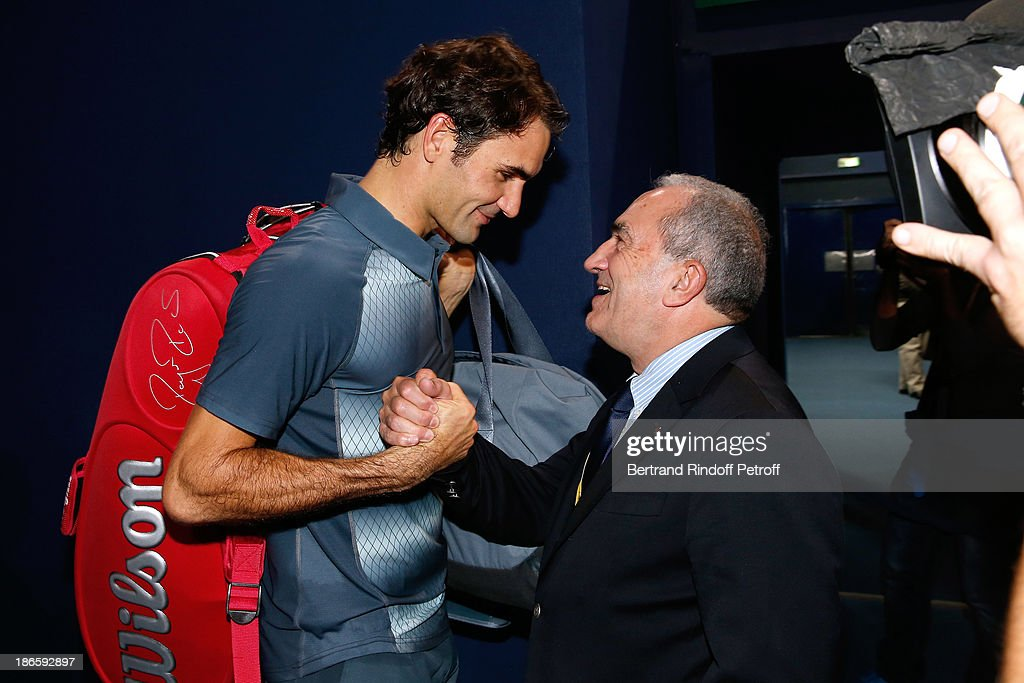 Tennis player <a gi-track='captionPersonalityLinkClicked' href=/galleries/search?phrase=Roger+Federer&family=editorial&specificpeople=157480 ng-click='$event.stopPropagation()'>Roger Federer</a> and President of French Tennis Federation <a gi-track='captionPersonalityLinkClicked' href=/galleries/search?phrase=Jean+Gachassin&family=editorial&specificpeople=5701397 ng-click='$event.stopPropagation()'>Jean Gachassin</a> after a match during day five of BNP Paribas Tennis Masters held at Bercy on November 1, 2013 in Paris, France.