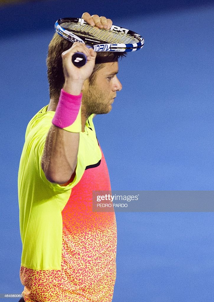 US tennis player Ryan Harrison reacts after loosing a point to Croatia's Ivo Karlovic, during their Mexico ATP tournament in Acapulco, Guerrero State, on February 26, 2015. AFP PHOTO / PEDRO PARDO