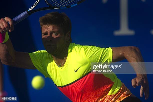 US tennis player Ryan Harrison returns the ball to Bulgaria's Grigor Dimitrov during the Mexico ATP tournament in Acapulco Guerrero State on February...