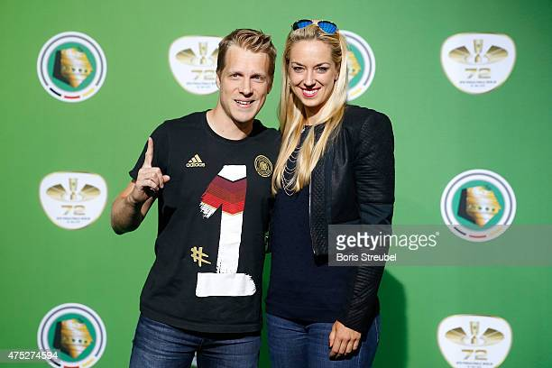 Tennis player Sabine Lisicki and her boyfriend Comedian Oliver Pocher poses at the green carpet prior to the DFB Cup Final between Borussia Dortmund...
