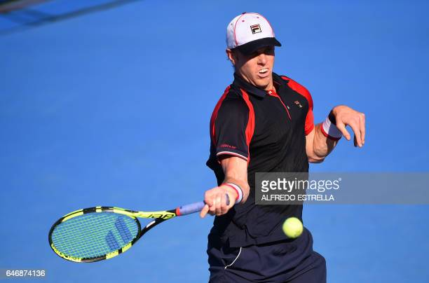 US tennis player Sam Querrey returns the ball to Belgian player David Goffin during the third day of the Mexican Tennis Open in Acapulco Guerrero...