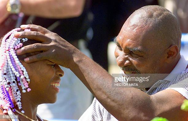 US tennis player Serena Williams is congratulated by her father Richard after winning her match against Lindsay Davenport of the US at the Evert Cup...