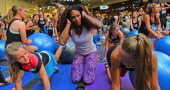 US tennis player Serena Williams joins fitness fans at a sponsor's workout training club in Melbourne on January 8 2013 Top tennis players are...