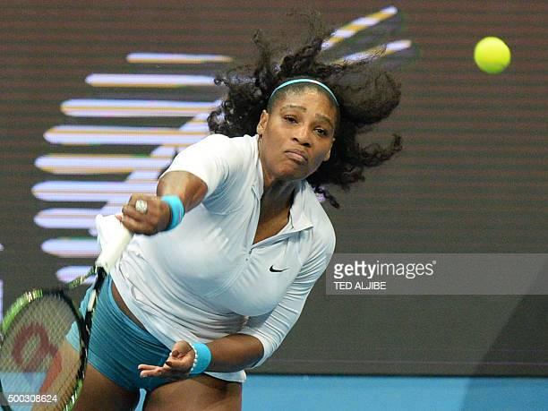 US tennis player Serena Williams of Philippine Mavericks serves against Croatias Mirjana LucicBaroni of Japan Warriors in the women's singles match...