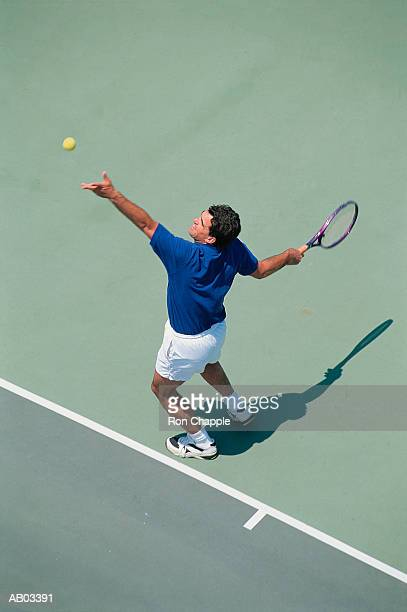 Tennis player serving, elevated view