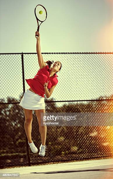 Tennis player serving