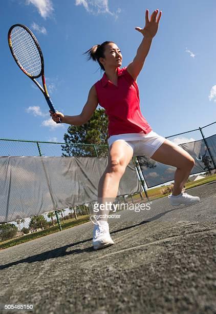 Tennis player sliding into forehand on har-tru tennis court