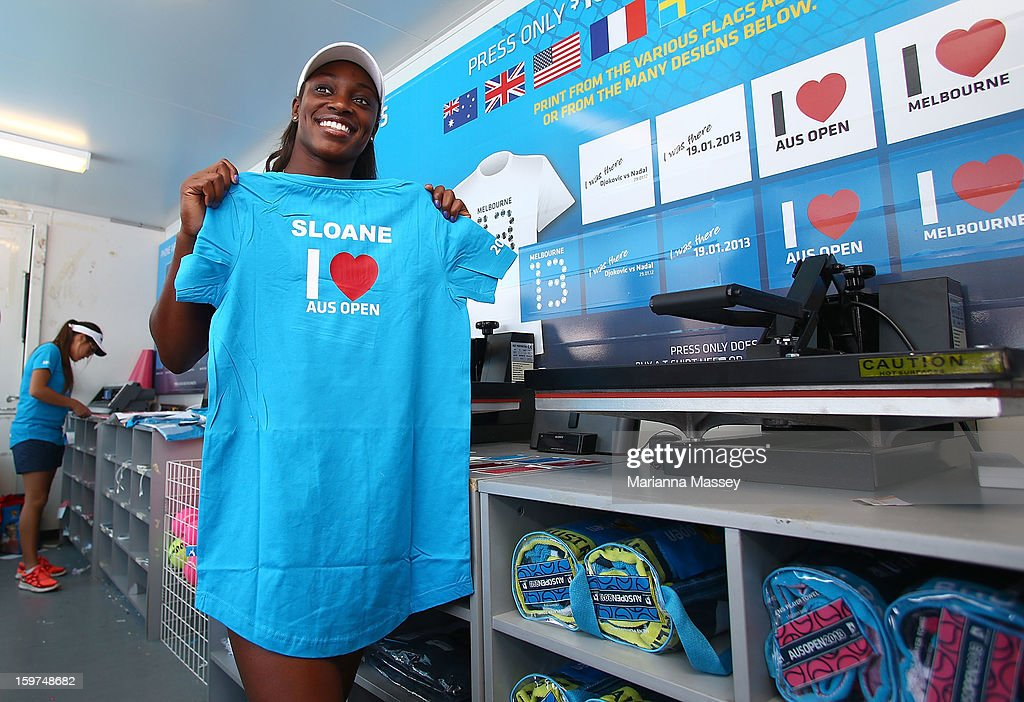 Tennis player Sloane Stephens makes a t-shirt with her name on it at the Australian Open shop during day seven of the 2013 Australian Open at Melbourne Park on January 20, 2013 in Melbourne, Australia.