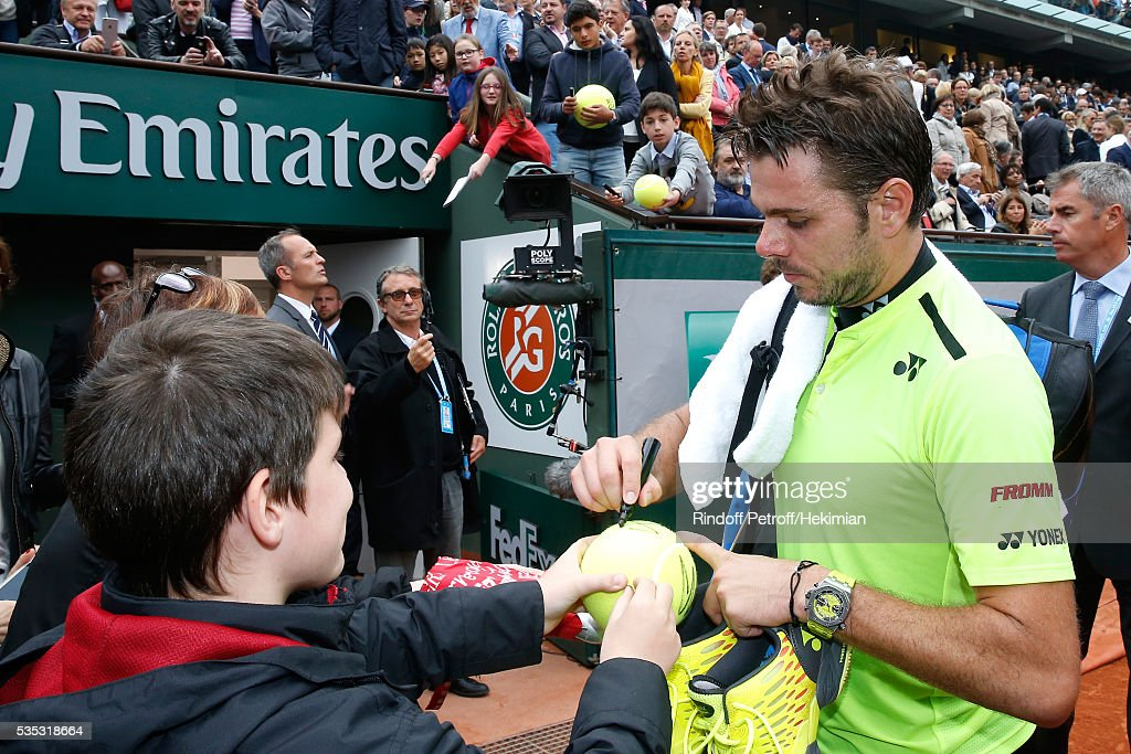 Tennis player <a gi-track='captionPersonalityLinkClicked' href=/galleries/search?phrase=Stanislas+Wawrinka&family=editorial&specificpeople=557155 ng-click='$event.stopPropagation()'>Stanislas Wawrinka</a> signs autographs at the end of his Match on Day Height of the 2016 French Tennis Open at Roland Garros on May 29, 2016 in Paris, France.