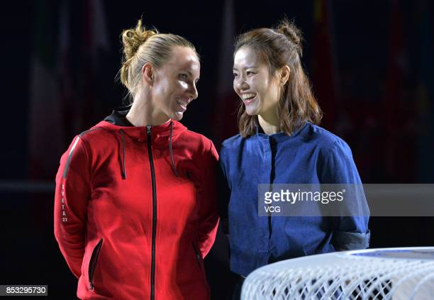 Tennis player Svetlana Kuznetsova and former tennis player Li Na attend the opening ceremony of 2017 WTA Wuhan Open at Optics Valley International...