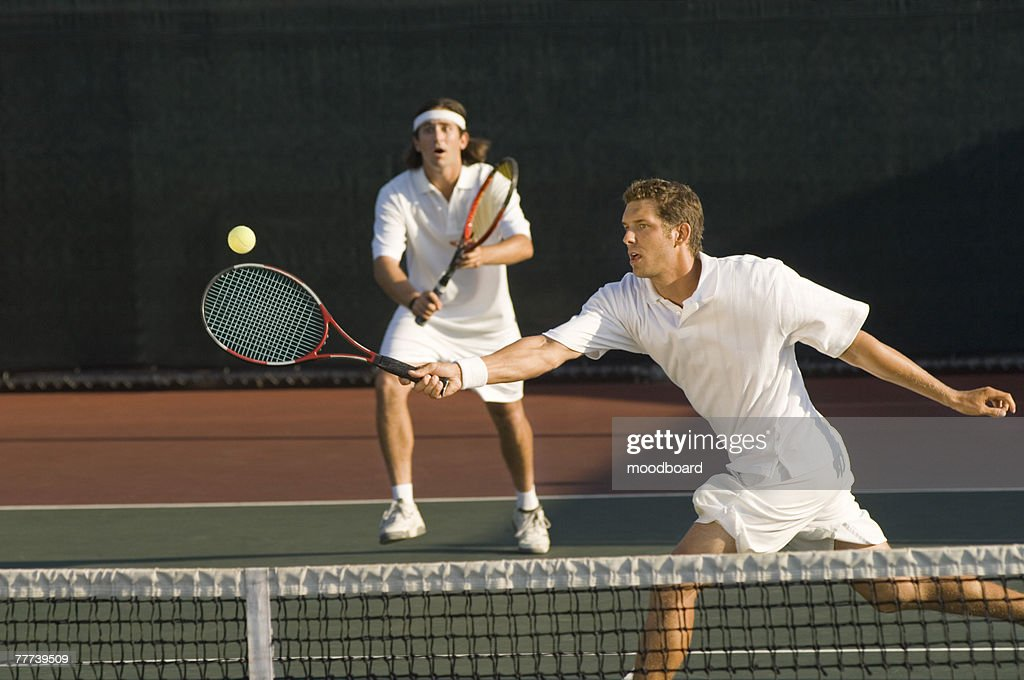 Tennis Player Swinging at Ball : Stock Photo
