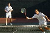 Tennis Player Swinging at Ball