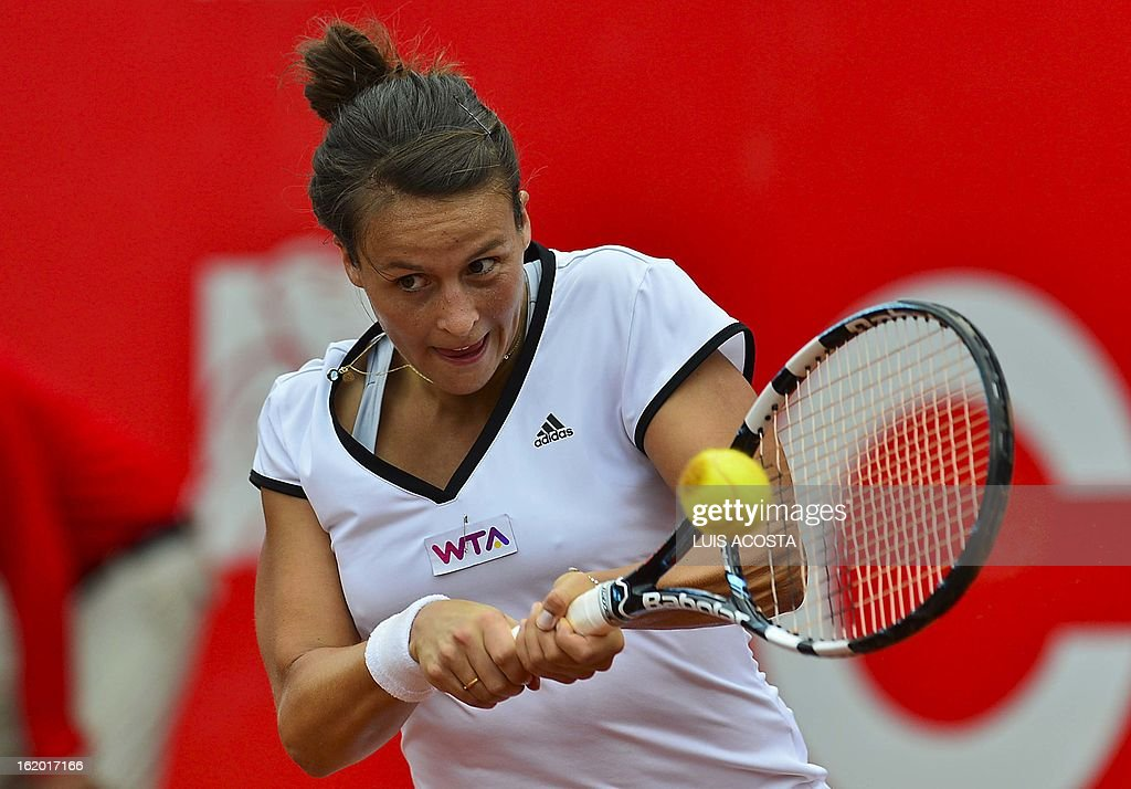 Tennis player Tatjana Malek of Germany returns the ball to Mandy Minella of Luxemburg during their WTA Bogota Open match, in the Colombian capital Bogota, on February 18, 2013. AFP PHOTO/Luis Acosta