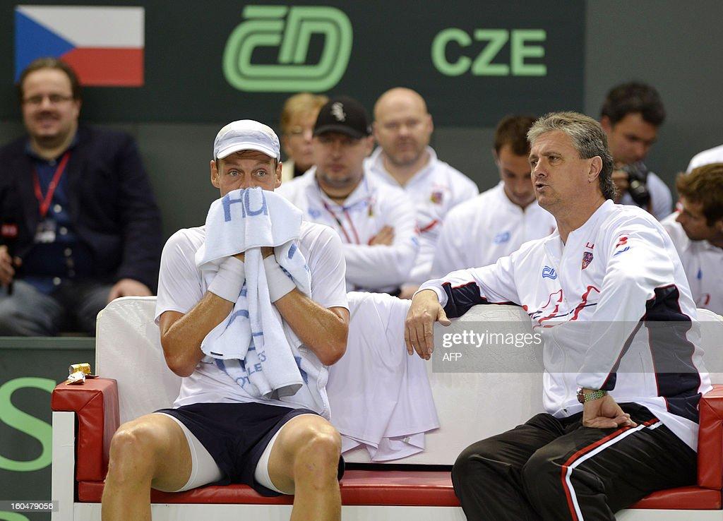 Tennis player Tomas Berdych (L) of the Czech Republic sits alongside Czech captain Jaroslav Navratil during a Davis Cup World Group first round game opposing Switzerland to the 2012 winner Czech Republic, on February 1, 2013, in Geneva.